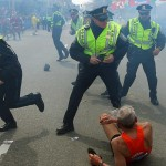 Police officers reacting to the Boston Marathon bomb attack