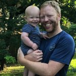 Dave Fleet and son enjoying paternity leave